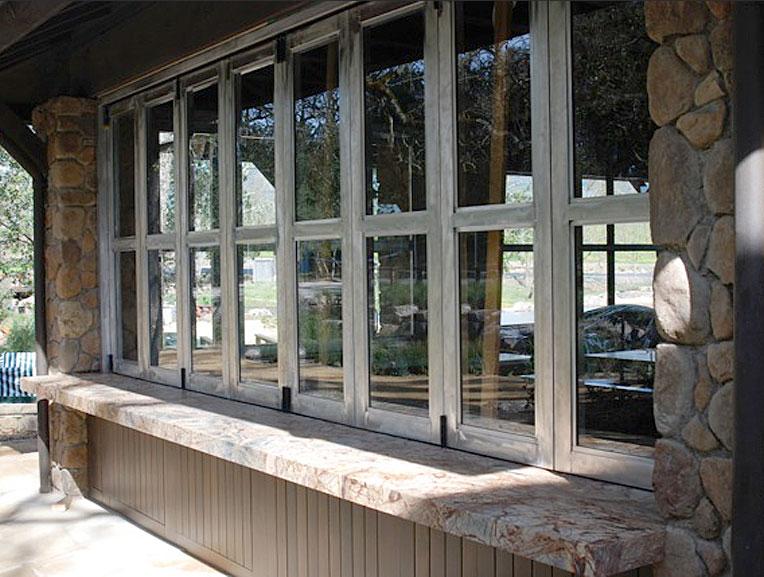 Northstar woodworks craftsmanship bi folding windows for Folding window wall